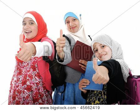 Arabic Muslim girls wearing Islamic clothes showing thumb up