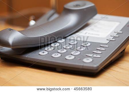 Closeup image of office phone on a table