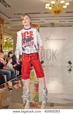 MOSCOW - MAR 17: Teenage boy model performs at podium of Children Gallery Yakimanka during 5th Yakimanka Kids Fashion Week, March 17, 2012, Moscow, Russia.