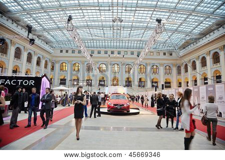 MOSCOW - APR 4: People and Volvo cars in Gostiny Dvor on day of opening of 27th season Volvo Fashion Week, April 4, 2012, Moscow, Russia. This event is supported by Government of Moscow.