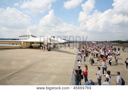 ZHUKOVSKY - AUGUST 12: Airplane Valentine Blyznyuk and spectators on airshow devoted to 100 anniversary of Russian Air Forces on August 12, 2012 in Zhukovsky, Moscow region, Russia.