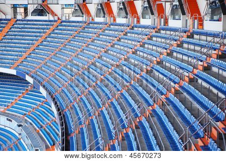 MADRID - MAR 8: Blue grandstand in Santiago Bernabeu Stadium - arena of soccer club Real Madrid, Mar 8 2012 Madrid, Spain. Spanish football club Real Madrid named FIFA best football club in XX century