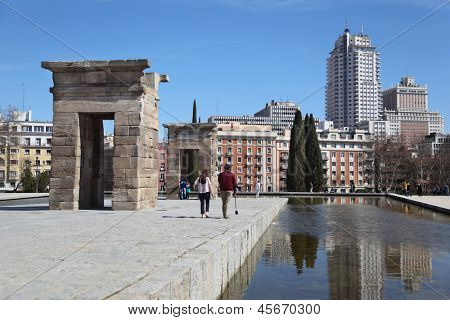 MADRID - MARCH 10: Tourists walk near Temple of Debod, on March 10 2012 in Madrid, Spain. People from the UK, Germany, France and Russia - is a major part of tourists to Spain in 2012.