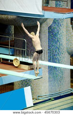 MOSCOW - APR 13: Athlete performs jump from springboard at Pool of SC Olympic on day of third phase of the World Series of FINA Diving, April 13, 2012, Moscow, Russia.