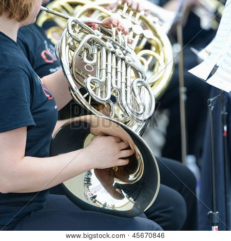 Playing French Horn instrument
