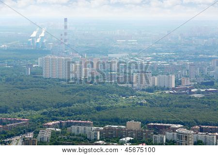 Houses and park in Sokolniki and Bogorodskoe districts at cloudy day in Moscow, Russia.