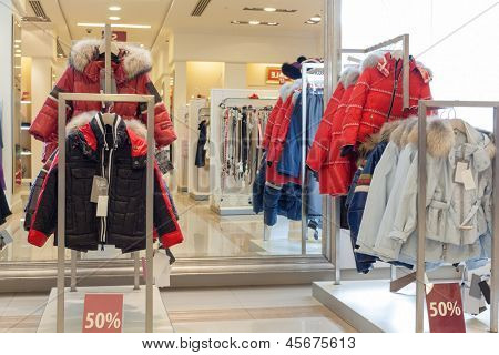 Racks with jackets in clothing store