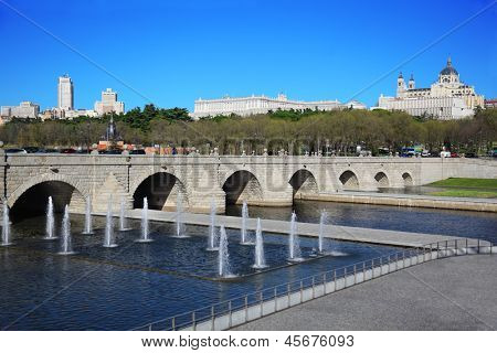 Bridge of Segovia, fountains, Royal Palace and Cathedral of Nuestra Senora de la Almudena in Madrid, Spain.