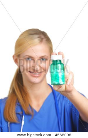 Nurse Holding Pills With Focus On Bottle