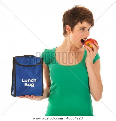 Woman with lunch bag is eating an apple