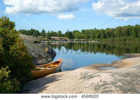 Canoe Beside Lake