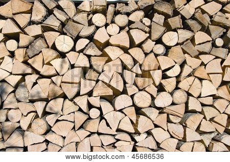 logs of firewood split and stacked (Brajcino)