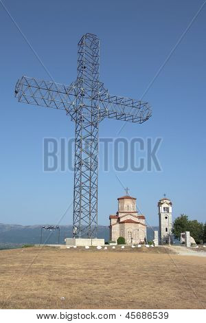giant metal structure in the shape of a cross over the orthodox church of Sveti Petar i Pavle in Podmocani, Macedonia Republic
