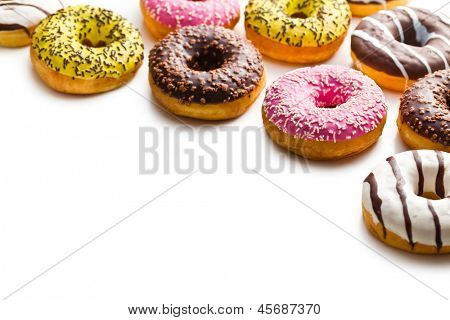 various donuts on white background