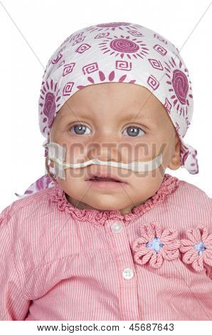 Adorable baby with a headscarf beating the disease isolated on white background