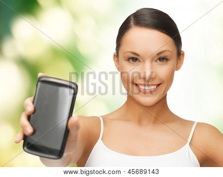 beautiful sporty woman showing smartphone with app