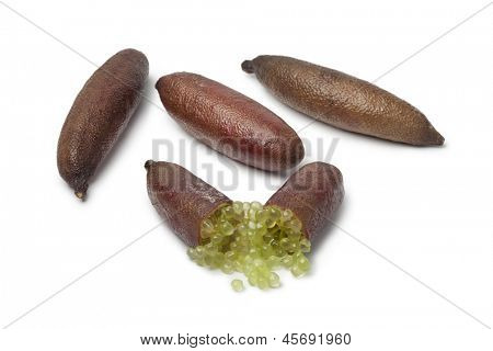 Whole and half lime finger on white background
