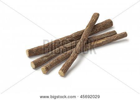 Liquorice roots on white background