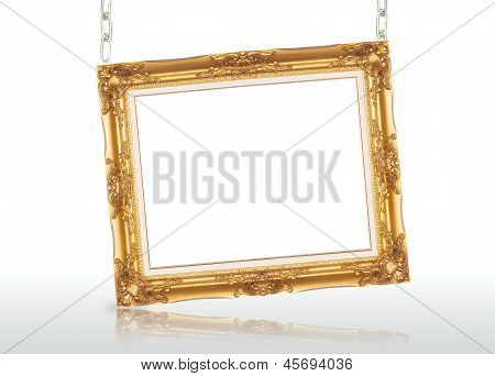Golden Picture Frame And Chains With Reflection On Isolated White Background