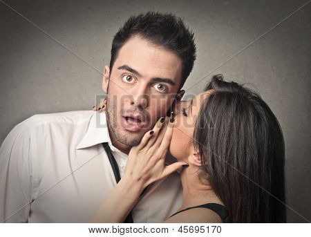 beautiful woman talking to her lover in the ear