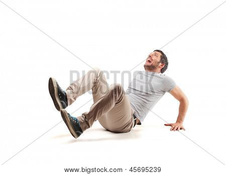 frightened man sitting on the floor