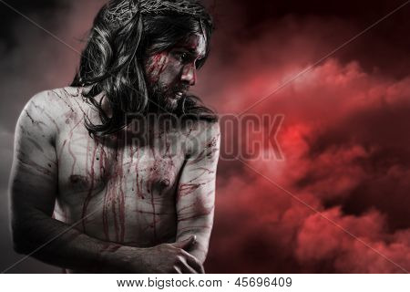 Jesus Christ over red cloudscape, calvary concept