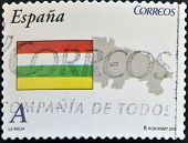 A stamp printed in spain shows flag and map of the autonomous community of La Rioja
