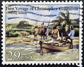 A stamp printed in USA dedicated to first voyage of christopher columbus shows coming ashore