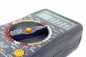 stock photo of ohm  - Modern digital multimeter isolated on a white background - JPG