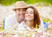 Romantic couple having fun at spring park, cheerful family enjoys countryside vacation, happy boyfri