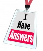 The words I Have Answers on an employee or assistant's badge and lanyard to illustrate helpfulness,