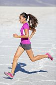 Running woman - runner sprinting on trail run in desert nature landscape. Female sport fitness athle