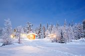 Winter landscape with cabin hut at night in Kiruna Sweden at Night with star trail