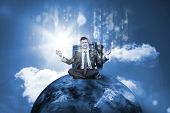 Businessman sitting on top of the world with data server and glowng matirx on blue sky background