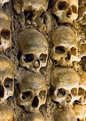 stock photo of chapels  - Wall full of skulls and bones in the bone chapel in Evora - JPG