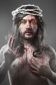 stock photo of sacred heart jesus  - Jesus Christ with a halo of white light over grey background - JPG