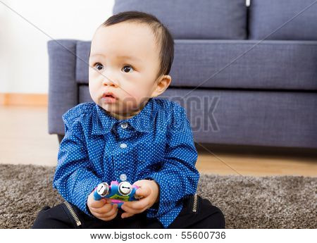 Asian baby boy playing toy