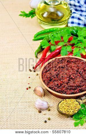 Adjika With Hot Pepper And A Napkin On Burlap