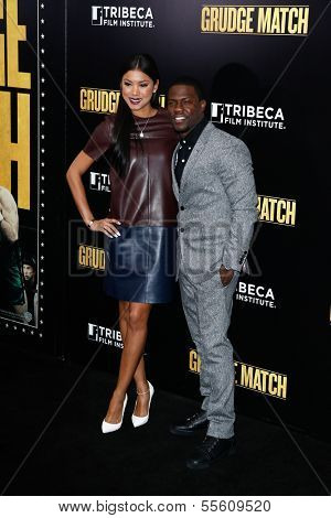 "NEW YORK-DEC 16: Actor Kevin Hart and Eniko Parrish attend the world premiere of ""Grudge Match"" at the Ziegfeld Theatre on December 16, 2013 in New York City."