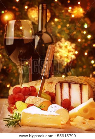 Christmas eve dinner, fine dining restaurant, romantic cheese and wine table, winter holidays celebration