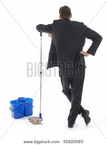 Businessman wit mop as cleaner