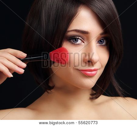 Woman Applying Blusher The Big Red Brush. Closeup Portrait