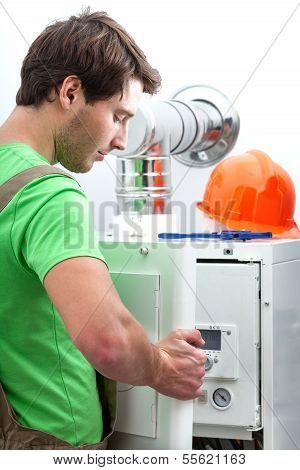 Handyman Repairing Boiler
