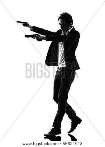 one asian gunman killer  in silhouette isolated white background