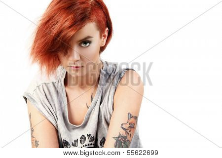 Young tattooed girl on white background
