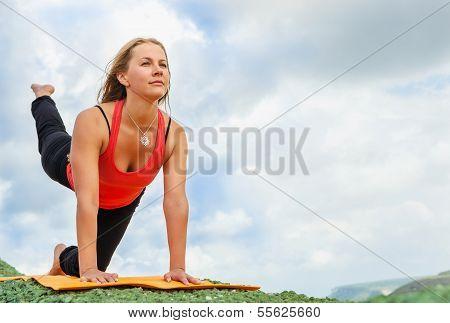 Yuong Woman Makes Flexible Yoga Exercise