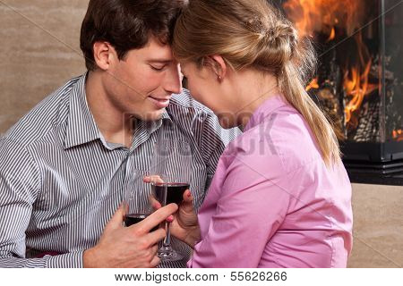 Couple Drinking By Fire
