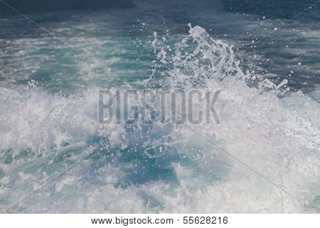 Wake of speed boat in the sea