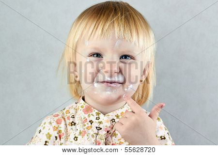 Happy  Little Girl  With Cream On Her Face