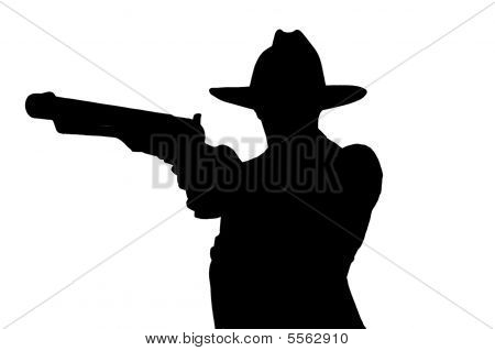 young cowboy in silhouette
